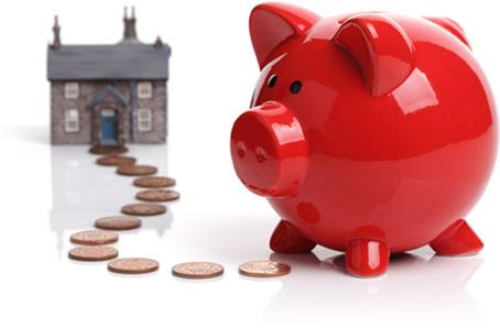 Piggybank saving money on purchasing a house